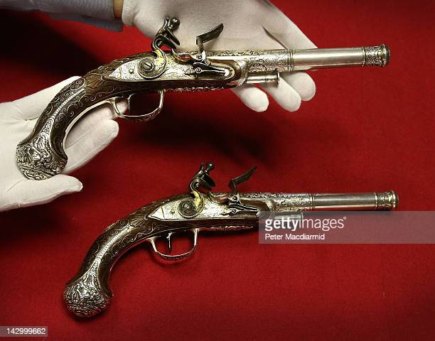 Pair of Indian 28-Bore Silver-Mounted Flintlock Pistols are displayed at Bonhams Auctioneers on April 17, 2012 in London, England. The pistols, circa...