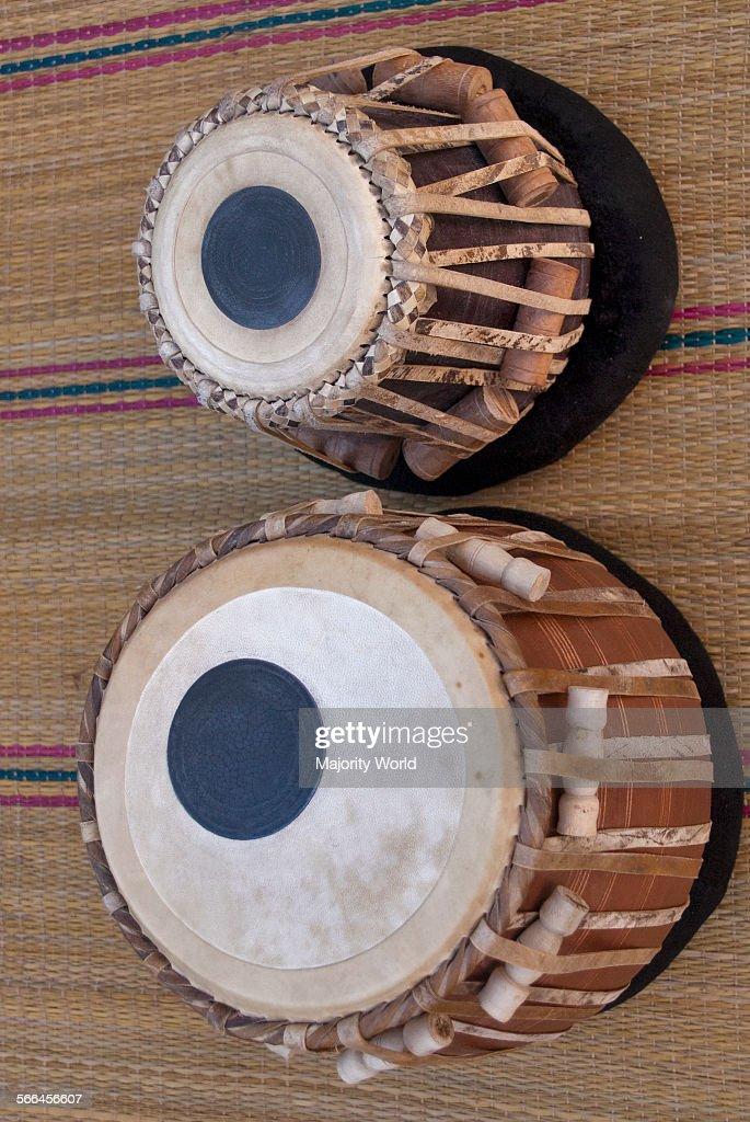 A pair of Indian drums or Tabla   Tabla is used in both