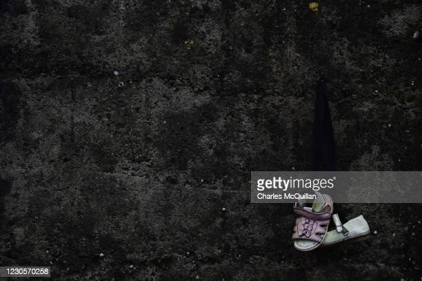 Pair of infant shoes are seen hanging from a wall at the shrine on a mass burial site which was formerly part of the Bon Secours Mother and Baby home...