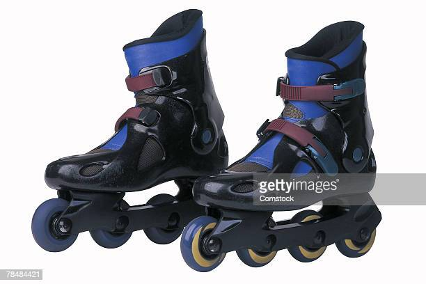pair of inline skates - inline skate stock photos and pictures