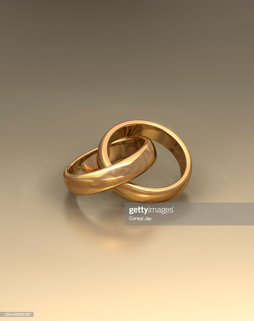 Pair Of Interlinked Wedding Rings Stock Photo Getty Images