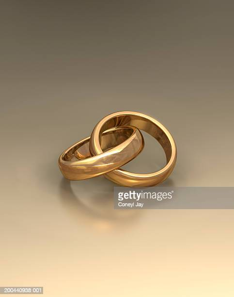 Pair of interlinked wedding rings