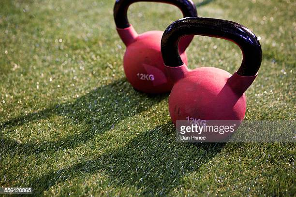 Pair of kettlebells on lawn