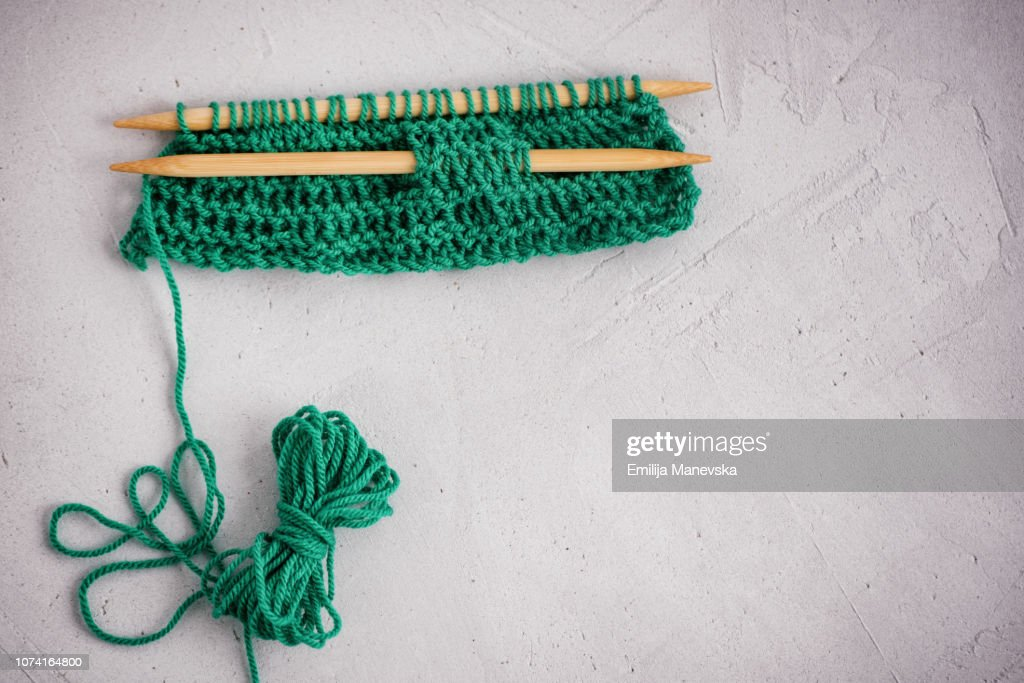 A pair of knitting needles, knitting and a ball of yarn : ストックフォト
