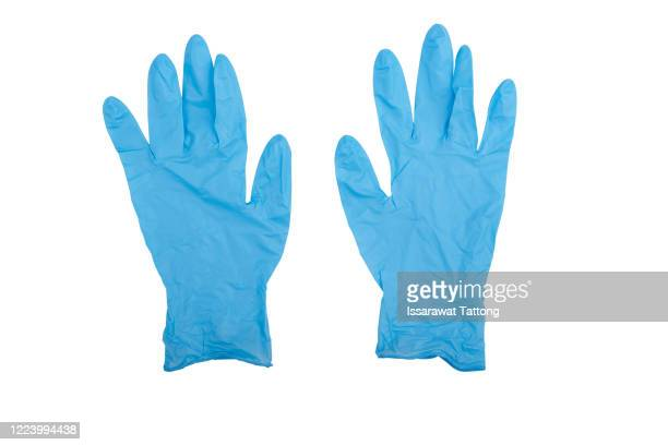 pair of latex medical gloves isolated on white background. protection concept - surgical glove stock pictures, royalty-free photos & images