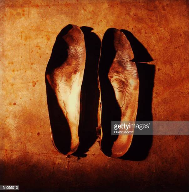 A pair of leather insoles
