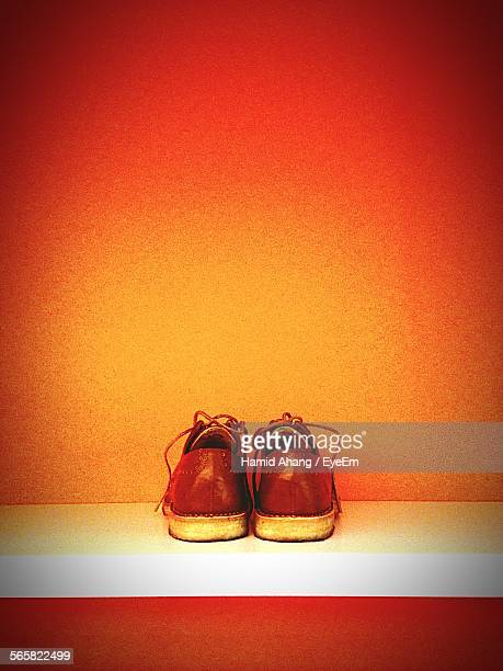 Pair Of Leather Shoes On Shelf