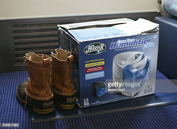 A pair of LL Bean boots and a humidifier travel with Democratic presidential hopeful Senator John Kerry of Massachusetts aboard his campaign plane at...