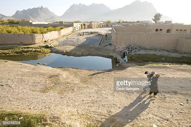 A pair of local men make their way to a meeting point for a Canadian Provincial Reconstruction Team Cash for Work project | Location Punjwai Kandahar...