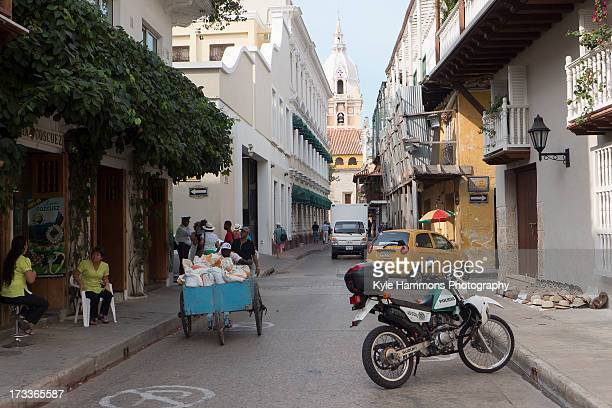 CONTENT] A pair of local women chat on a sidewalk in the old town at Cartagena Colombia Surrounded by 13km of centuriesold stonewalls the old town at...