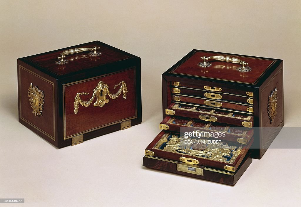 Pair of Louis XIV style coin cabinets : News Photo