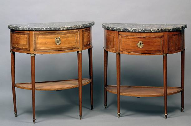 Louis XVI style crescent shaped console tables Pictures | Getty Images