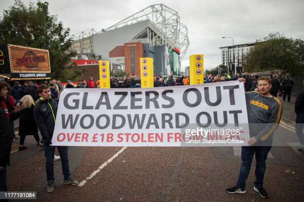 A pair of Man Utd fans hold up a banner against the club's owners the Glazers as well as Man Utd Chief Executive Ed Woodward before the Premier...