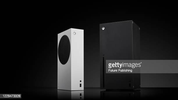 Pair of Microsoft home video game consoles, including an Xbox Series S and Xbox Series X, taken on October 27, 2020.