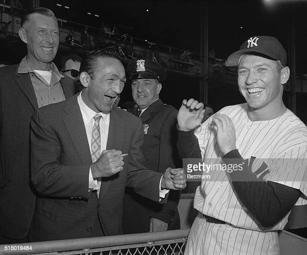 A pair of mighty sluggers engaged in a spot of preseries clowning as Carmen Basilio middleweight boxing champ squares off with Mickey Mantle who does...