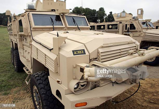 A pair of Mine Resistant Ambush Protected vehicles or MRAP's are parked on the test course at the US Army's Aberdeen Proving Ground in Aberdeen...