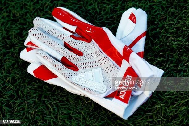 A pair of Nebraska Cornhuskers Adidas gloves is seen on the field before the game at Memorial Stadium on September 29 2017 in Champaign Illinois