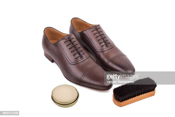 pair of new brown leather male shoes with shoe care kit, brush and shoe wax - oxford shoe stock-fotos und bilder