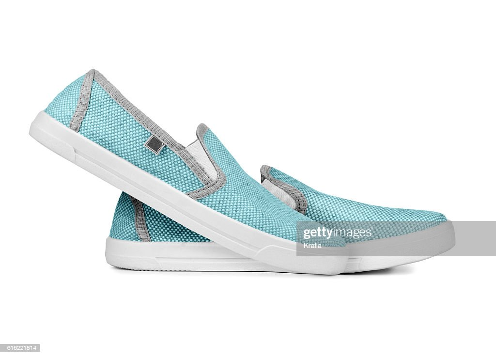 Pair of new light sneakers isolated on a white background : Stock Photo