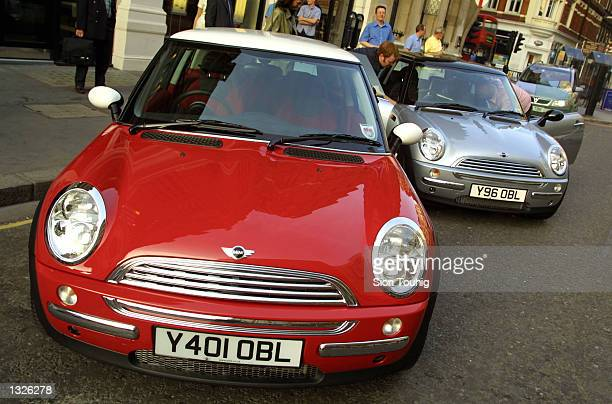 A pair of new Mini Cooper cars is unveiled to the auto industry press June 25 2001 in London England The Mini a 42yearold brand is now manufactured...