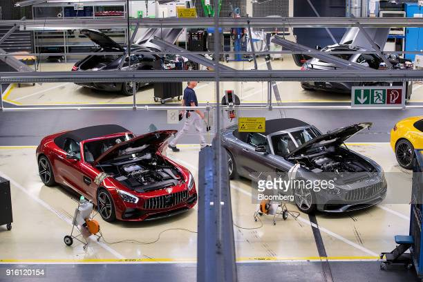 A pair of newly assembled MercedesBenz AG AMG GT high performance luxury automobiles undergo final quality control checks at the automaker's plant in...