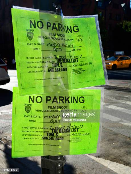 A pair of 'No Parking' signs taped to a street sign in Midtown Mahnattan issued by the New York Mayor's Office The signs advise motorists that the...