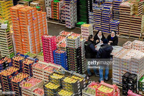 A pair of nuns talk to wholesalers in the fruit and vegetable section of Rungis wholesale food market in Rungis France on Thursday Jan 15 2015 Bank...