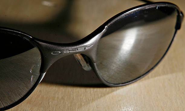 A pair of Oakley sunglasses is arranged for a photograph in Pictures ... b410376805