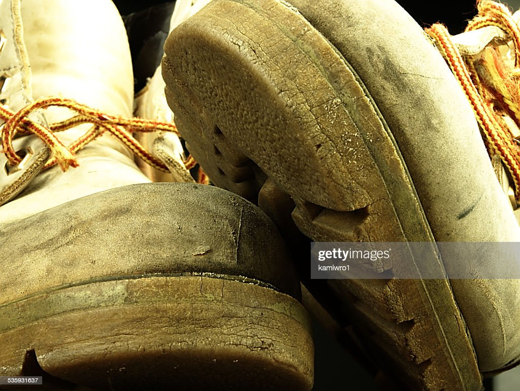 Pair of old, worn heavy boots. : Stock Photo