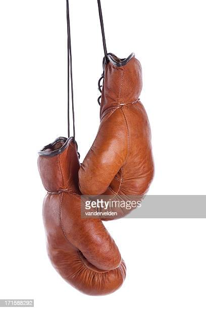 pair of old-fashioned boxing gloves on a white background - boxing gloves stock photos and pictures