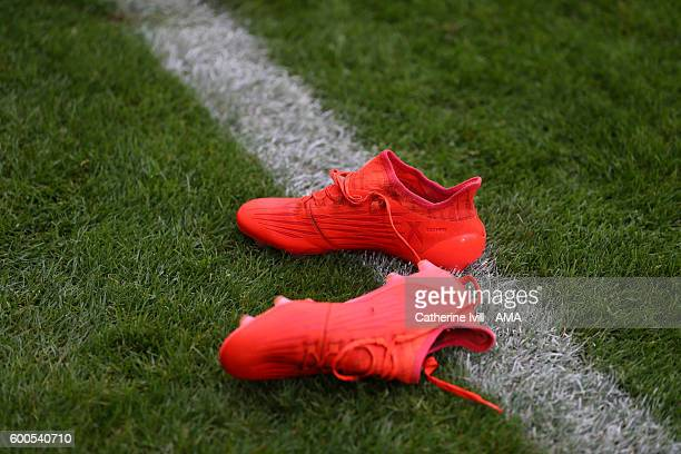 A pair of orange adidas boots lie on the pitch during the UEFA European U21 Championship Qualifier Group 9 match between England U21 and Norway U21...