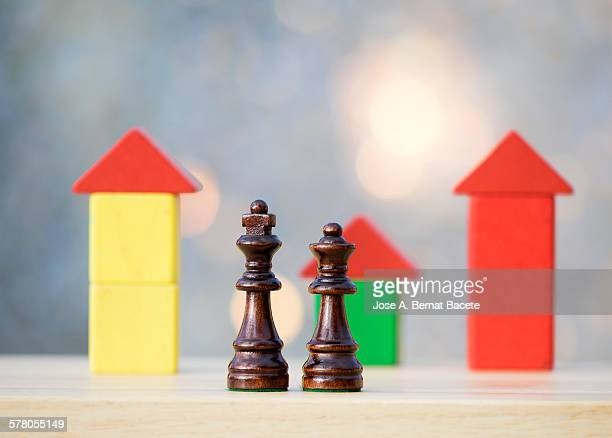 pair of pieces of chess walking between the houses - between stock pictures, royalty-free photos & images