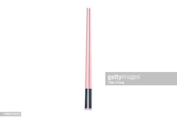 a pair of pink chopsticks with white background - changzhou stock pictures, royalty-free photos & images