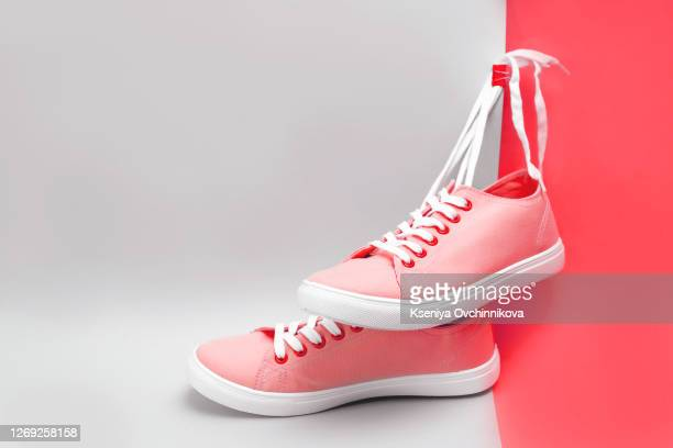 pair of pink sport shoes isolated on white background, pair of sneakers isolated on white background - pink shoe stock pictures, royalty-free photos & images