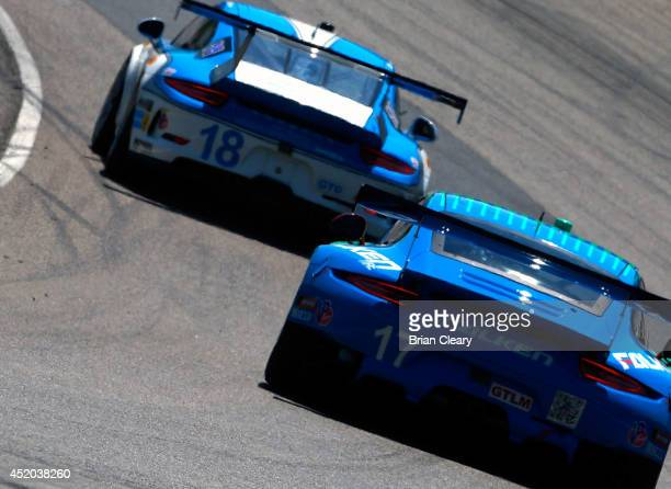 A pair of Porsches during practice for the Mobil 1 SportsCar Grand Prix at Canadian Tire Mosport Park on July 11 2014 in Bowmanville Ontario Canada