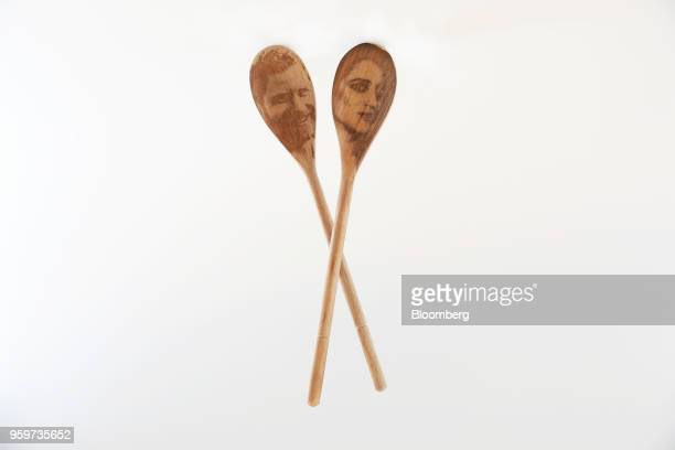 A pair of Prince Harry Meghan Markle decorative wooden spoons manufactured by SquirrelPigeonFish sit in this arranged photo in London UK on Friday...