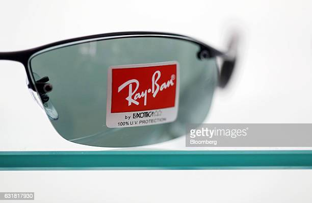 1f8cc8b485d A pair of RayBan sunglasses manufactured by Luxottica Group SpA stand on  display in an opticians