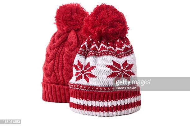 Pair of red bobble hats