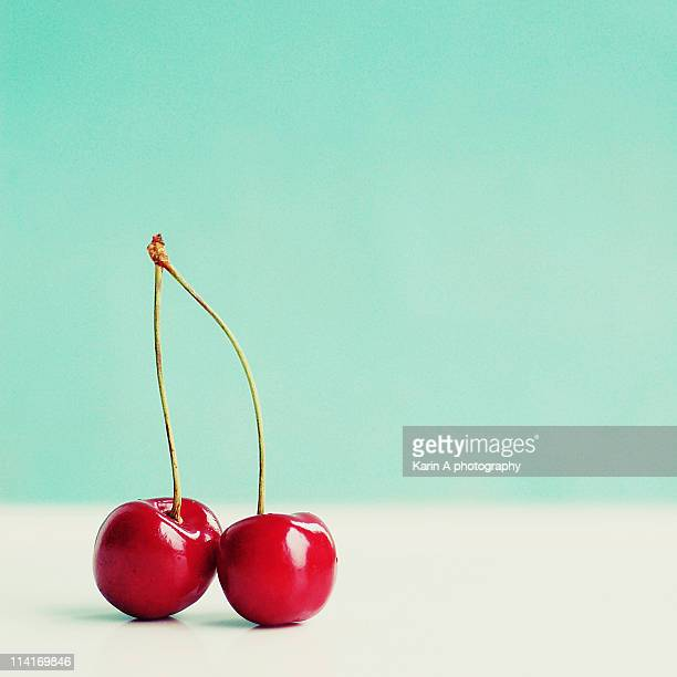 pair of red cherries - cherry stock pictures, royalty-free photos & images