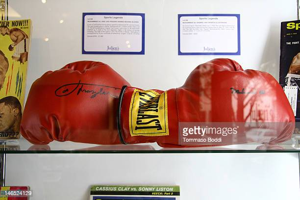 A pair of red Everlast boxing gloves signed by Muhammad Ali and Joe Frazier are displayed at the Julien's Auctions press call for Music Icons And...