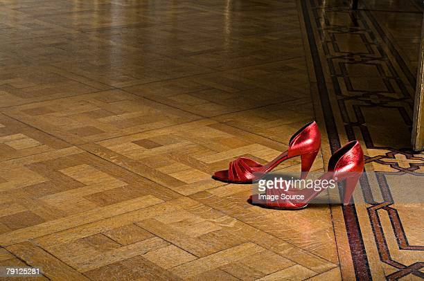 pair of red high heeled shoes - stiletto stock pictures, royalty-free photos & images
