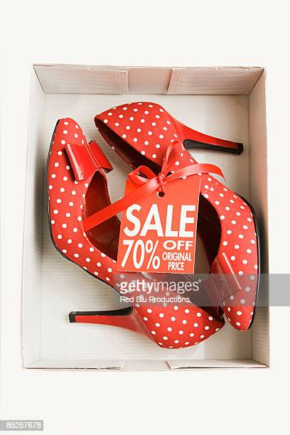 Pair of red high heeled shoes