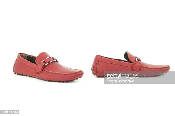 Pair of red leather loafers isolated on white background