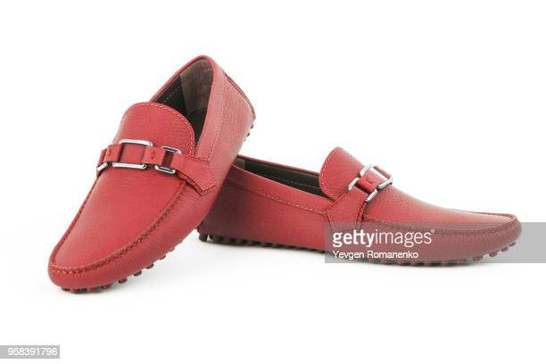 pair of red leather loafers isolated on white background - loafer stock pictures, royalty-free photos & images