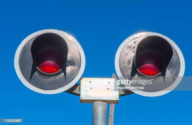A pair of red lights in a railway crossing