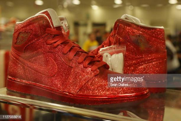 A pair of red Nike Legends of Summer Sparkling valued at approximately $8500 on display by Sarmiento Inc during SneakerCon 2019 at Fort Lauderdale...