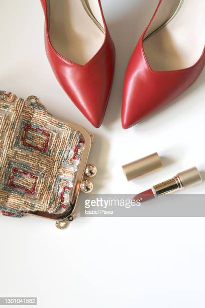 pair of red stilettos shoes and evening bag. flat lay - gold purse stock pictures, royalty-free photos & images