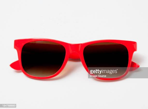 pair of red sunglasses - sunglasses stock pictures, royalty-free photos & images