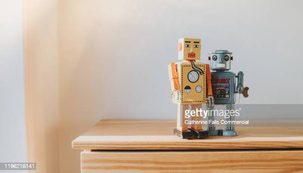 pair of robots - antique stock pictures, royalty-free photos & images