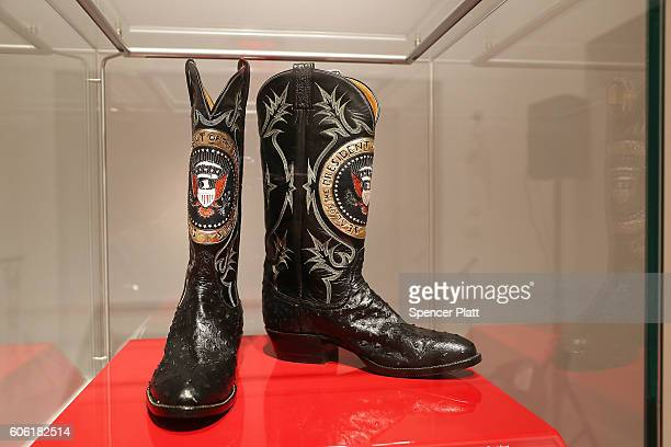 A pair of Ronald Reagan's cowboy boots sit in a case at Christie's where items from the former president and Nancy Reagan's California home are to be...